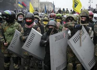 Members of the Ukrainian protest movement stood guard at barricades in Kiev on Saturday.